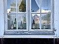 Bottles in a window at Sätra brunn.jpg