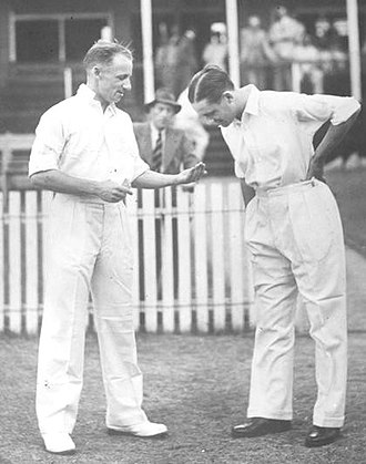 Coin flipping - Tossing a coin is common in many sports, such as cricket, where it is used to decide which team gets the choice of bowling or batting first. Shown are Don Bradman and Gubby Allen tossing for innings.