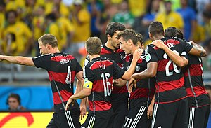 2014 FIFA World Cup knockout stage - Miroslav Klose (center) celebrating with fellow teammates after scoring the second goal for Germany.
