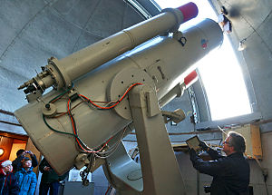 Schmidt camera - The 77 cm Schmidt-telescope from 1966 at Brorfelde Observatory was originally equipped with photographic film, and an engineer is here showing the film-box, which was then placed behind the locker at the center of the telescope (at the telescope's prime focus)
