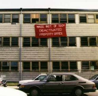 """Building 20 - In 1998, shortly before the building's demolition, students added a giant """"deactivated"""" sign, an oversized copy of the sticker attached to decommissioned MIT equipment."""