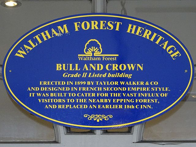 Blue plaque № 9678 - The Bull and Crown. Grade II Listed building - Erected in 1899 by Taylor Walker and Company and designed in French Second Empire style. It was built to cater for the vast influx of visitors to the nearby Epping Forest and replaced an earlier 18th century inn