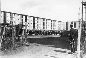 Drancy internment camp - View of the accommodation block at Drancy with French gendarme on guard