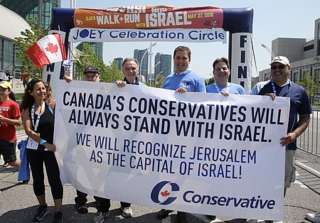 Peter Kent with party leader Andrew Scheer in 2018 stating their position of the status of Jerusalem. The Conservatives' support for Israel was partially responsible for the riding's political shift. CPC for Israel.jpg