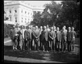 Calvin Coolidge and group outside White House, Washington, D.C. LCCN2016889032.tif