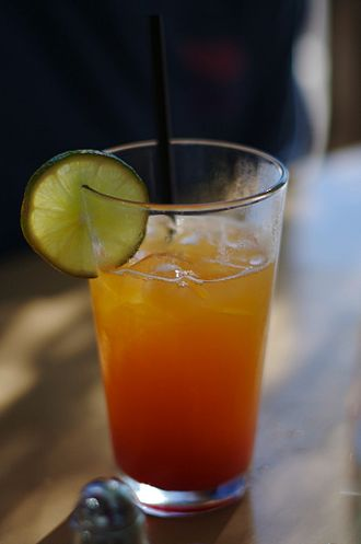 Non-alcoholic mixed drink - The Shirley Temple mocktail, made from grenadine, 7-Up and orange juice, and served with lime