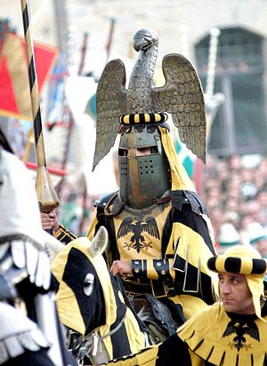 Crest (heraldry) - A knight with an eagle crest at the Saracen Joust in Arezzo, Tuscany.