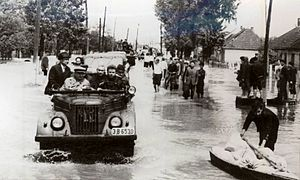 1970 floods in Romania - Nicolae Ceauşescu (at left, wearing a cap) rides through Satu Mare two days after it was devastated by floods.