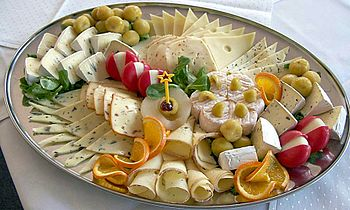 Variety of cheeses on serving platter