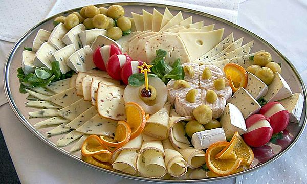 A platter with cheese and garnishes