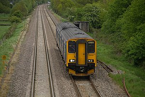 Brockley, Somerset - A First Great Western service on the Bristol to Taunton Line passes the bridge at Chelvey Lane.