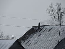 Chimney on the roof of a wooden house2.jpg