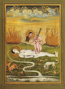 A nude, decapitated Chhinnamasta holds her severed head in her right hand and a sword in the left. She seats squatting on and in coitus with a white-complexioned naked Shiva lying on the ground. Cremation pyres appear in the background. Dogs and jackals feast on severed human heads in the foreground.