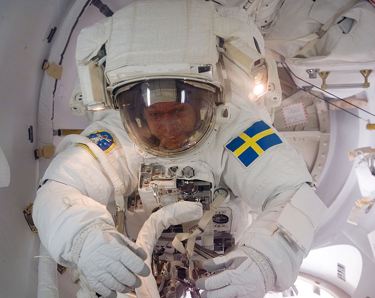 As the mission's first spacewalk draws to a close, European Space Agency (ESA) astronaut Christer Fuglesang, STS-116 mission specialist, moves through the Quest Airlock as he returns to the International Space Station.