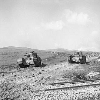 Operation Ochsenkopf - Image: Churchill tanks go into action near Ksar Mesouar, Tunisia, 28 February 1943. NA911