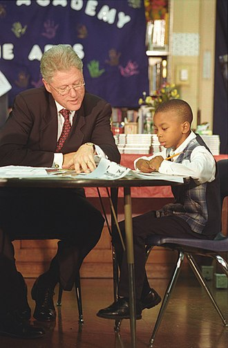 Public image of Bill Clinton - Clinton reading with a child in Chicago, September 1998.