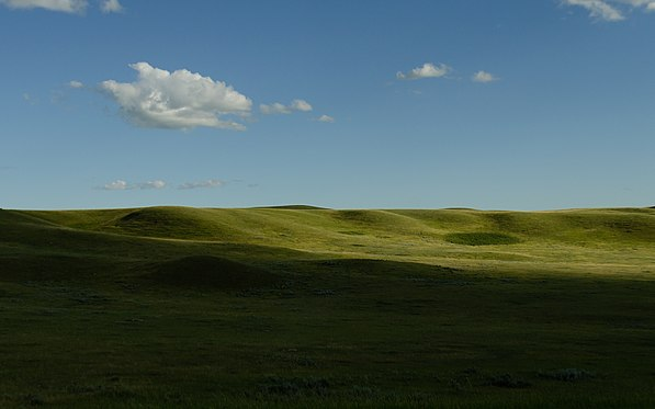 Cloud shadows over hills in Grasslands National Park.jpg