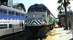 Coaster F40PHM-2C locomotive #2104 with Amtrak Pacific Surfliner #572 behind it at Solana Beach Station, California