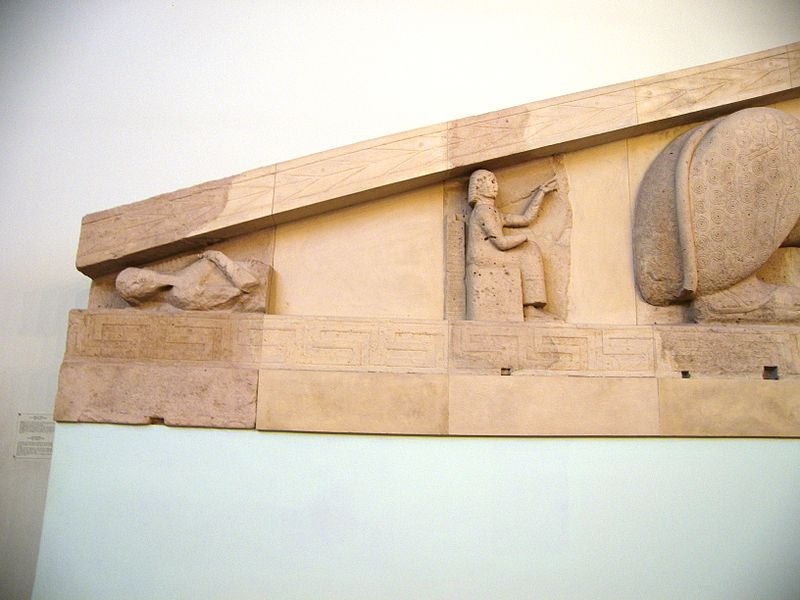 File:Corpse and seated figure at the Artemis Temple pediment in Corfu.jpg