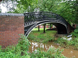 A small iron bridge over a stream
