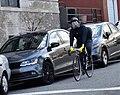 Cyclist in gas mask in Weehawken, NJ.jpg