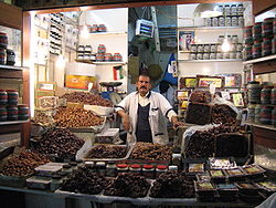 Many Muslims traditionally break their fasts in Ramadan with dates (like those offered by this date seller in Kuwait City), as was the recorded practice (Sunnah) of Muhammad.