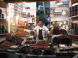 Five Pillars of Islam - Muslims traditionally break their fasts in the month of Ramadan with dates (like those offered by this date seller in Kuwait City), as was the recorded practice (Sunnah) of Muhammad.