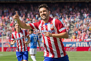 Spanish football player David Villa celebrating after scoring a goal for Atlético de Madrid.