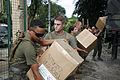 Defense.gov News Photo 101014-M-2755L-004 - U.S. Marines and sailors with Marine Air Group 36 3rd Marine Expeditionary Brigade unload supplies at Calumpang Elementary School in Mabalacat.jpg