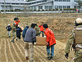 Defense.gov News Photo 110320-F-8880L-194 - Airmen work alongside a team of Japanese medical workers to unload food water and medical supplies from a pair of HH-60G Pave Hawk helicopters at.jpg