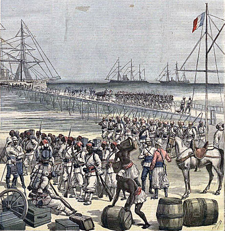 In 1892, the Senegalese Tirailleurs, led by Colonel Alfred-Amedee Dodds, invaded Dahomey (present-day Benin). Desembarco en Cotonou de tropas senegalesas. Le Petit Journal, 21may1892.jpg