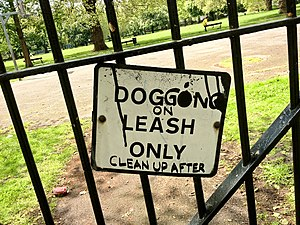"Dogging (sexual slang) - Vandalised ""Dog On Leash Only"" sign amended to refer to dogging, Kennington Park, London, 2012"