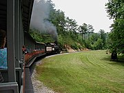Dollywood features a full-size steam train, one of the park's signature attractions.