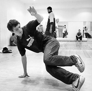 Breakdancing - A b-boy practicing downrock at a studio in Moscow.