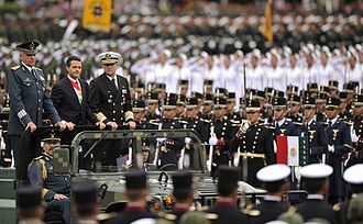 Mexican Armed Forces - President Enrique Peña Nieto accompanied by the Secretary of National Defense, Salvador Cienfuegos Zepeda, and the Secretary of the Navy, Vidal Francisco Soberón Sanz, during a military parade.
