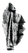 Black and white photograph of a helmet fragment from the East Mound at Gamla Uppsala