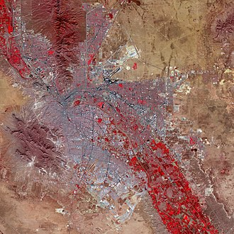 El Paso, Texas - False-color satellite image of El Paso and Ciudad Juárez: Paved streets and buildings appear in varying shades of blue-gray, and red indicates vegetation