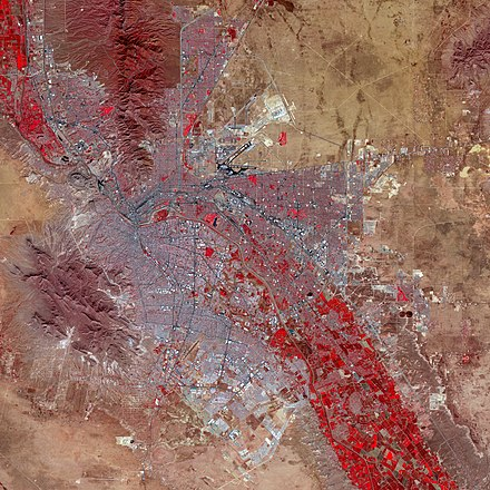 False-color satellite image of El Paso and Ciudad Juarez: Paved streets and buildings appear in varying shades of blue-gray, and red indicates vegetation El Paso, Texas.jpg
