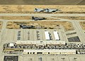 F-35Cs of VFA-101 in flight over NAS Lemoore with FA-18EFs of VFA-122 in April 2015.JPG