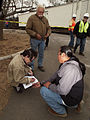 FEMA - 33727 - A Tribal worker assigns temporary housing to fire victims in California.jpg