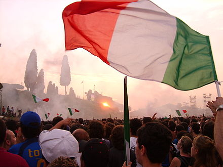 Within the crowd in the Circus Maximus in Rome, after the Italian team scored against France. FIFA world cup 2006 - Rome circus maximus flag.jpg