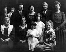 "Andrew's wife Lizzie (Bolden) Tozier is seated far left. Andrew Jr. (""AJ) is standing second from right."