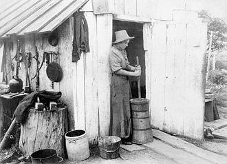Churning (butter) - Farmer girl churning butter