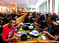 Food in Wikimania 2012, Wikimedians eating.JPG