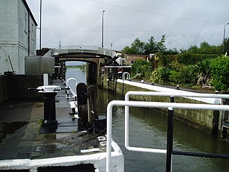 Foss Dyke - Torksey Lock, looking towards the River Trent. Four sets of gates are visible, and a further two sets are situated beyond the bridge.