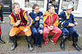 Four Spanish soldiers sitting on a bench april 1 event Brielle.jpg