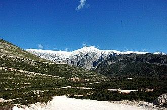 Albanian Ionian Sea Coast - Maja e Çikës inside the Ceraunian Mountains as seen from the beach of Dhërmi.