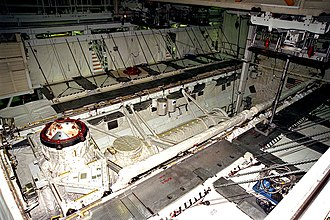 Getaway Special - GAS canisters shown mounted in the shuttle cargo bay. This image is from STS-91. The front of the shuttle is to the left of the picture.