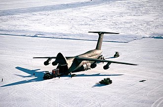 Lockheed C-5 Galaxy - Personnel unload cargo from a C-5 Galaxy at Pegasus Field, an ice runway near McMurdo Station, Antarctica in 1989.