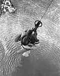 Gemini 11 astronaut Pete Conrad is hoisted aboard a recovery helicopter, 15 September 1966 (66-H-1216).jpg